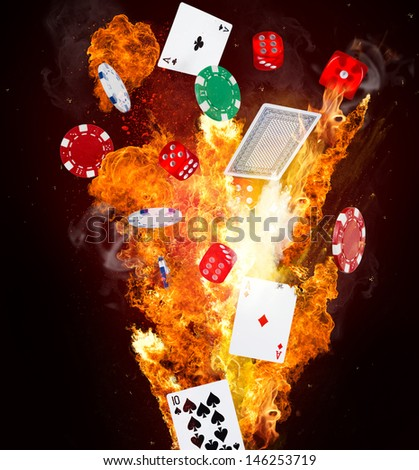 Poker chips, cubes and playing cards in motion - stock photo