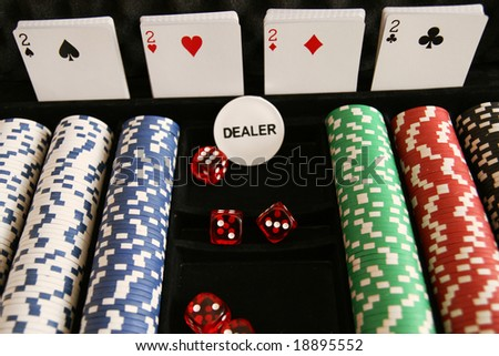 poker chips, dice, cards, dealer chip - stock photo