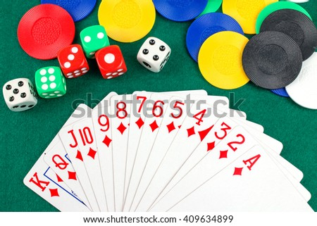 Poker Chips, Dices  and Cards on Green Table.