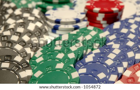 Poker chips fanned out on table