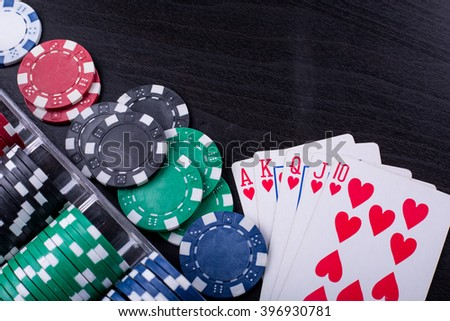 Poker chips for casino game on the table. - stock photo