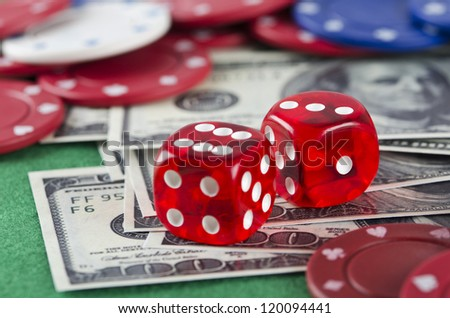 Poker chips, money and dice on green background - stock photo
