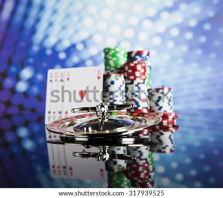 Poker Chips on a gaming concept - stock photo