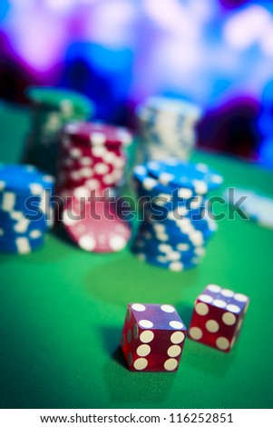 Poker Chips on a gaming table - stock photo