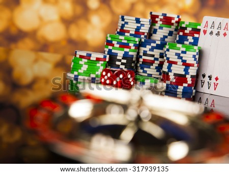 Poker Chips on a gaming with casino roulette - stock photo