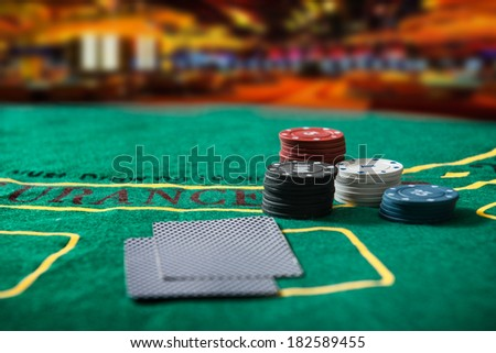 Poker chips on a poker table at the casino - stock photo