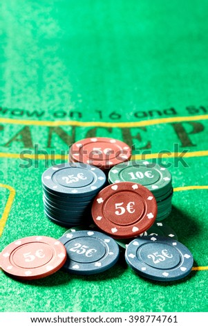 Poker chips on a poker table. Vertical image.