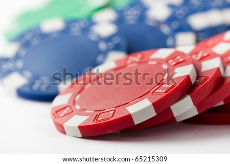 Poker chips on a white background. Small DOF. - stock photo