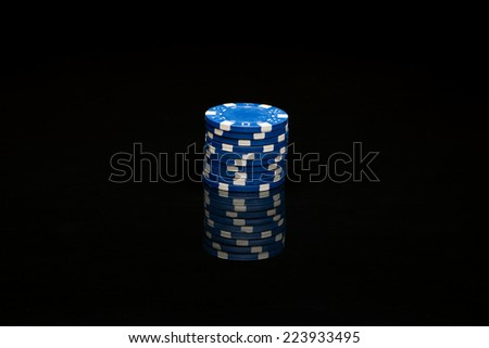 Poker chips on black background with reflexion - stock photo