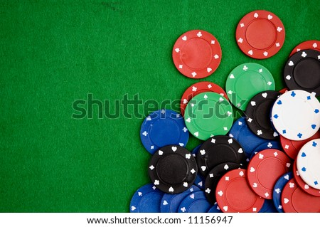 Poker chips on green background. Room for text.