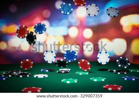 Poker chips on table in casino - stock photo