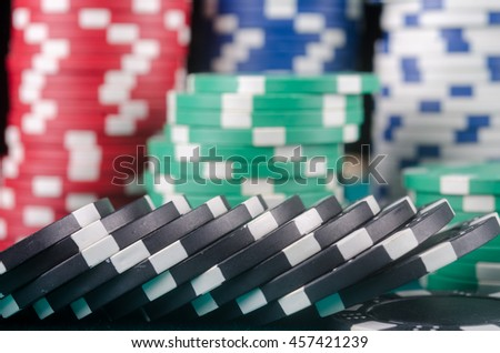 Poker chips on the table. Quality studio shot.