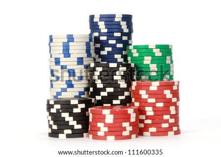 Poker chips on white background - stock photo