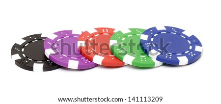 Poker chips on white background - stock photo