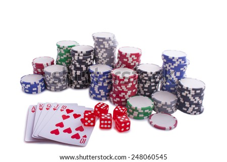 Poker chips with cards and dices isolated on a white background