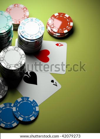 poker chips with two aces on green casino table - stock photo