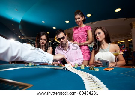 poker dealer displaying cards before starting the game - stock photo