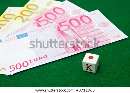 Poker dice and euro notes - stock photo