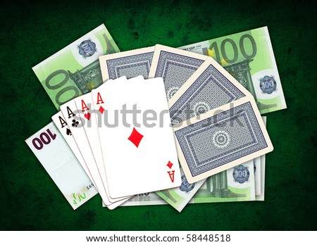 poker, four aces on a pile of money over the grungy green background, top view