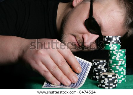 Poker gambler and casino chips close-up - stock photo