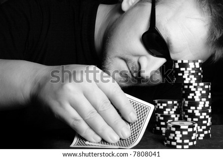 Poker gambler close-up. Black and white image. - stock photo