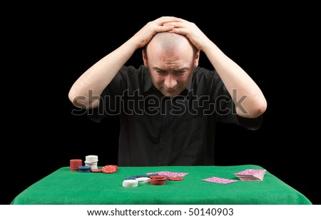 Poker gambler in black shirt.  Losings. Isolated over black