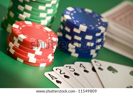 Poker game straight flush, chips and deck of cards