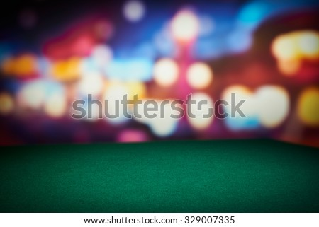 Poker green table in casino with blur background - stock photo
