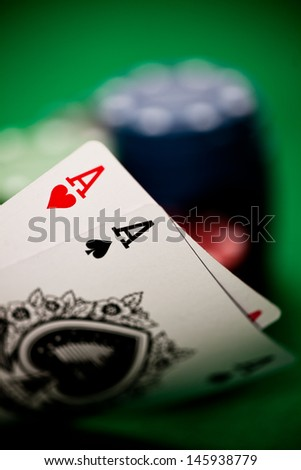 Poker hand with two aces - stock photo