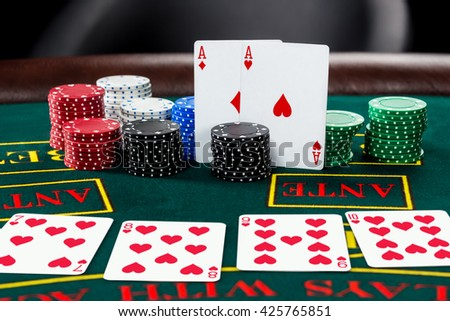 Poker play. Chips and cards - stock photo
