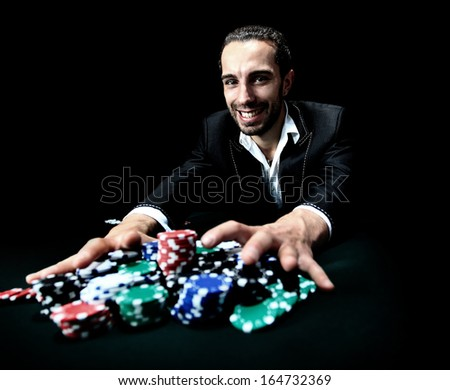 poker player betting everything on one hand - stock photo