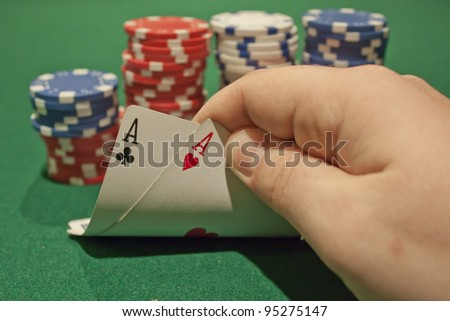 Poker player displaying a pair of aces.