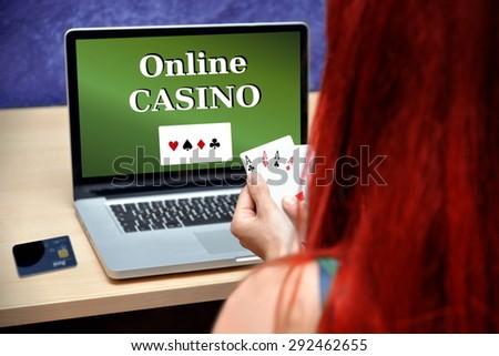 poker player gambling on online casino - stock photo