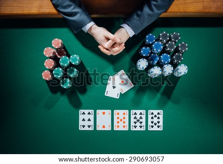 Poker Playeru0027s Hands With Cards And Stacks Of Chips All Around On Green Table,  Top