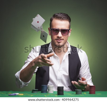 Poker player throwing cards at the table - stock photo