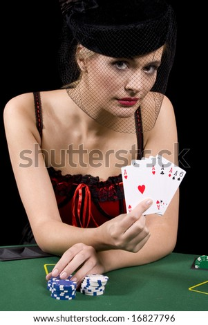 Poker playing showing the dealer her hand of four aces in a poker game - stock photo