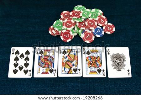 Poker royal flush combination on the table - stock photo