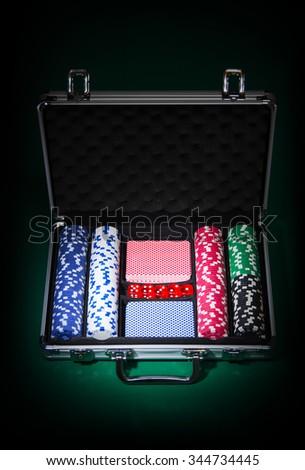 Poker set in metallic case - stock photo