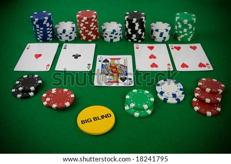 Poker set with chips and cards on the green table - big blind chip. - stock photo