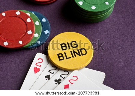 Poker set with chips and cards on the table - big blind chip. - stock photo