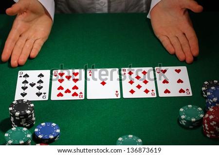 Poker setting on green table - stock photo