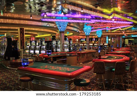 Poker tables and gaming slot machines in American gambling casino  - stock photo