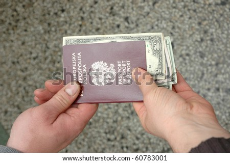 Pol;ish passport with bribe-dollars inside - stock photo