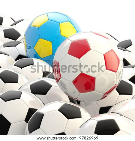 Poland and Ukraine football soccer balls over pile of usual ones - stock photo