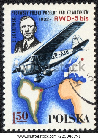 POLAND - CIRCA 1982: A postage stamp printed in Poland shows airplane SP-AJU and pilot of S.Skarzinski. First polish flight above Atlantica, circa 1982  - stock photo