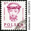 "POLAND - CIRCA 1982: A stamp printed in Poland from the ""Carved Heads from Wawel Castle"" issue shows Woman wearing chaplet, circa 1982. - stock photo"