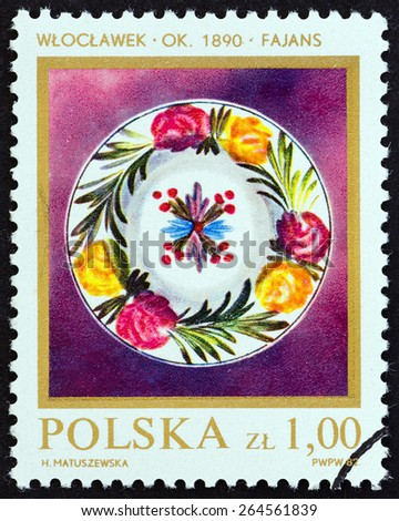 """POLAND - CIRCA 1982: A stamp printed in Poland from the """"Polish Ceramics """" issue shows Faience Plate, circa 1982.  - stock photo"""