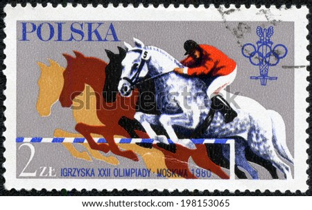 POLAND - CIRCA 1980: A stamp printed in POLAND, shows a Olympic games in Moskow. Steeplechase,horseb ack riding,athlete on a horse, circa 1980 - stock photo