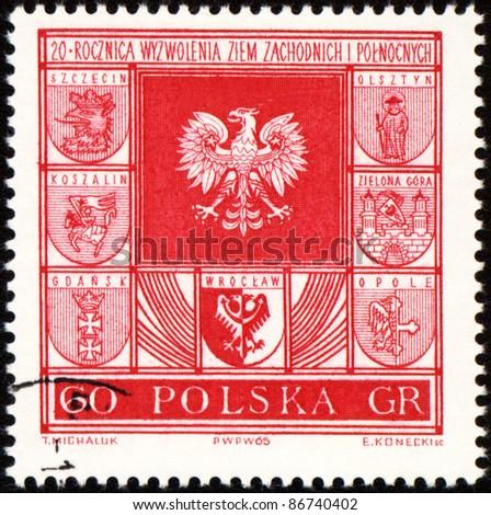 POLAND - CIRCA 1965: A stamp printed in Poland, shows arms of cities in Poland, circa 1965 - stock photo