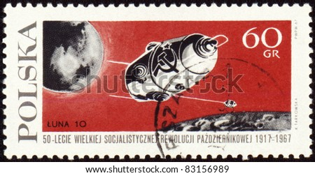 "POLAND - CIRCA 1967: A stamp printed in Poland shows flight of soviet automatic spaceship ""Luna-10"" to the Moon, circa 1967 - stock photo"